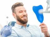 The patient is happy to get dental veneers.